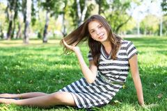 Young woman in summer park Stock Photo
