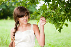 Young woman in a summer park Royalty Free Stock Images