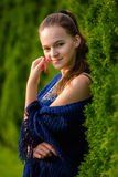 A young woman in a summer park. A beautiful young  girl in the green outdoor nature background Royalty Free Stock Image