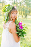 Young woman in the summer park Royalty Free Stock Image