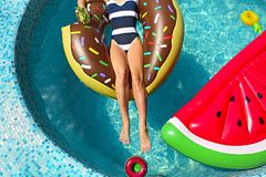 Young woman on summer pool party. In swimming pool drinkig lemonade stock images