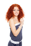 Young woman in a summer striped dress. Stock Image