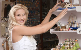 Young woman on summer vacancies shopping souvenirs. Stock Image