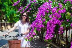 Young woman on summer vacation biking at beautiful Stock Photos