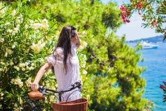 Young woman on summer vacation biking at tropical Royalty Free Stock Image