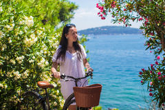 Young woman on summer vacation biking at tropical Stock Images