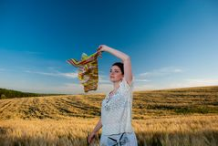 Young woman at summer wheat Royalty Free Stock Photos