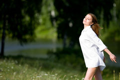 Young woman in the sun Stock Photography