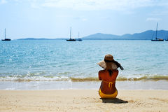 Young woman sun bathing on a sandy beach of Thailand Stock Photo