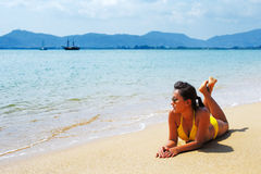 Young woman sun bathing on a sandy beach of Thailand Royalty Free Stock Photo
