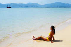 Young woman sun bathing on a sandy beach of Thailand Stock Image
