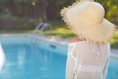Young woman sun bathing in spa resort swiming pool.  Stock Photography