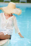 Young woman sun bathing in spa resort swiming pool Stock Photography