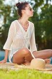 Young woman sun bathing in spa resort swiming pool Royalty Free Stock Image