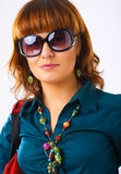 Young woman in sun glasses. Beautiful young woman in sun glasses Stock Images
