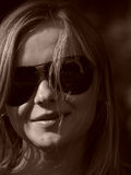 Young woman with sun glasses in sepia Stock Photos