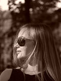 Young woman with sun glasses in sepia Royalty Free Stock Photography