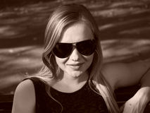 Young woman with sun glasses in sepia Stock Photography