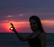 Young woman with the Sun in hand Royalty Free Stock Image