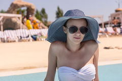 Young Woman in Sun Hat by Resort Swimming Pool Royalty Free Stock Photos