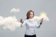 Young woman and sun shining out from behind the clouds, cloud computing or weather concept Royalty Free Stock Photos
