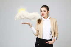Young woman and sun shining out from behind the clouds, cloud computing or weather concept Stock Photos