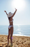 Young woman sunbathering at the seaside. Royalty Free Stock Image