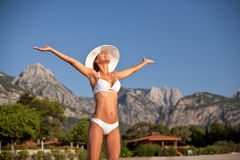 Young woman sunbathering at the seaside. Royalty Free Stock Images
