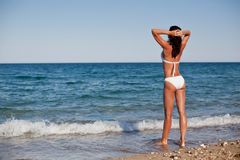 Young woman sunbathering at the seaside. Royalty Free Stock Photography