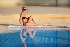 The young woman sunbathing Royalty Free Stock Photography