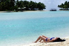 Young woman sunbathing in Aitutaki Lagoon Cook Islands Royalty Free Stock Photos