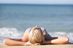 Young Woman Sunbathing On Beach Royalty Free Stock Photos
