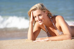 Young Woman Sunbathing On Beach Royalty Free Stock Image