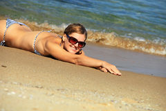 Young woman sunbathing at a beach Royalty Free Stock Photos