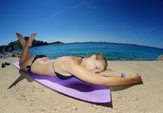 Young woman, sunbathing on a beach Royalty Free Stock Photography