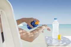Young woman sunbathing. At the beach Stock Photo