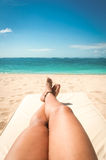 Young woman sunbathing on the beach Stock Photos