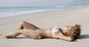 Young Woman Sunbathing In Bikini Stock Photos