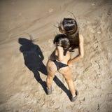 Young woman sunbathing in bikini Stock Image