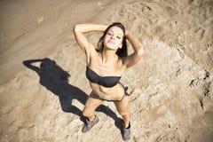Young woman sunbathing in bikini Stock Photography