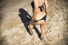 Young woman sunbathing in bikini Stock Photo