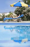 Young Woman Sunbathing In Bikini. On Sunbed By Swimming Pool stock images