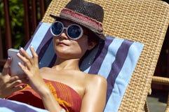 Young woman sunbathing Stock Photo