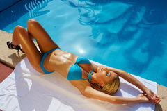 Young woman sunbathing Royalty Free Stock Images