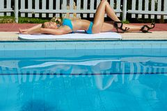 Young woman sunbathing Royalty Free Stock Photos