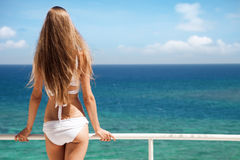 Young woman sunbathing. Nice sea view. Royalty Free Stock Photography