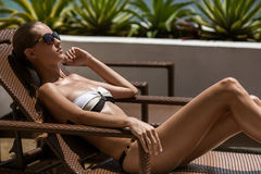 Young woman sunbathing. Resort and Spa. Royalty Free Stock Image