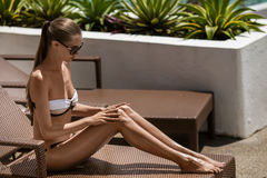 Young woman sunbathing. Resort and Spa. Stock Photography