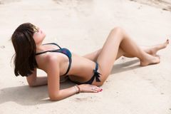 Young woman sunbathing on a sand Royalty Free Stock Photo