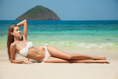 Young Woman Sunbathing At Tropical Beach Royalty Free Stock Image
